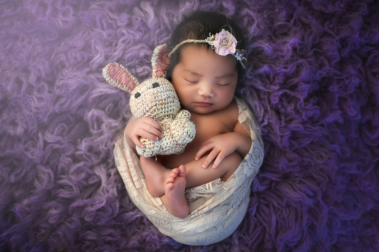 Newborn Baby Portrait on Purple in Fairfax Virginia